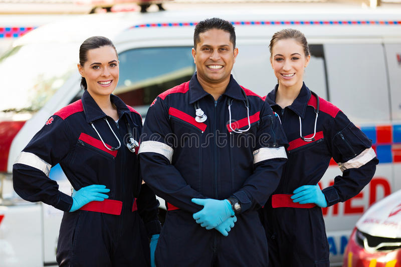 Group of paramedics. Standing in front of an ambulance royalty free stock photography