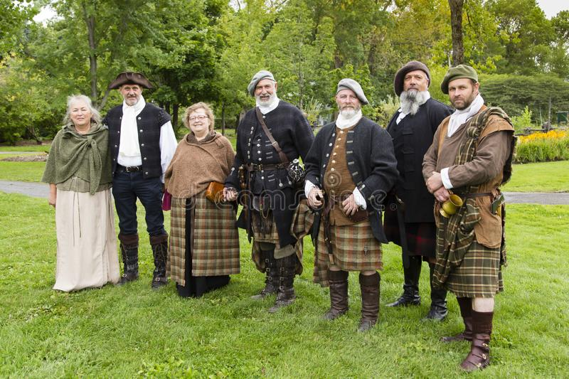 Group of participants in the Quebec Celtic Festival held in Domaine de Maizerets posing stock photos