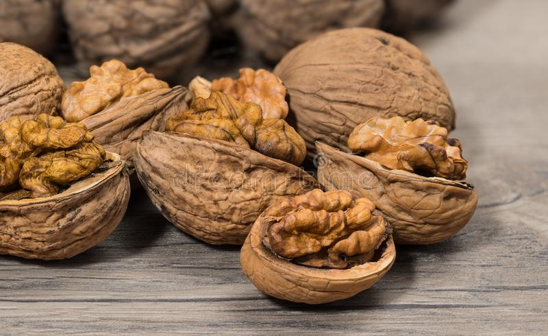 Group of partly peeled nuts with half shells closeup royalty free stock photography