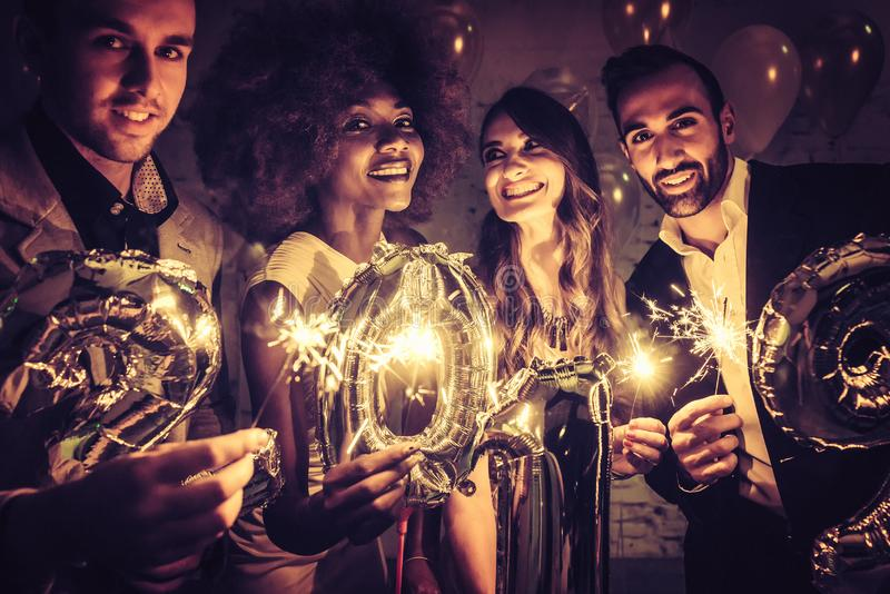 Group of party people celebrating the arrival of 2019 royalty free stock photos