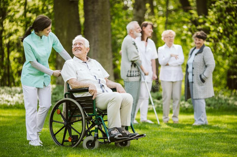 Group of patients and nurses in the nursing home. Group of patients and nurses in nursing home stock image