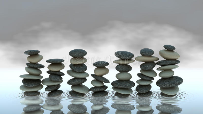 Group of Pebble stacks on water level stock images