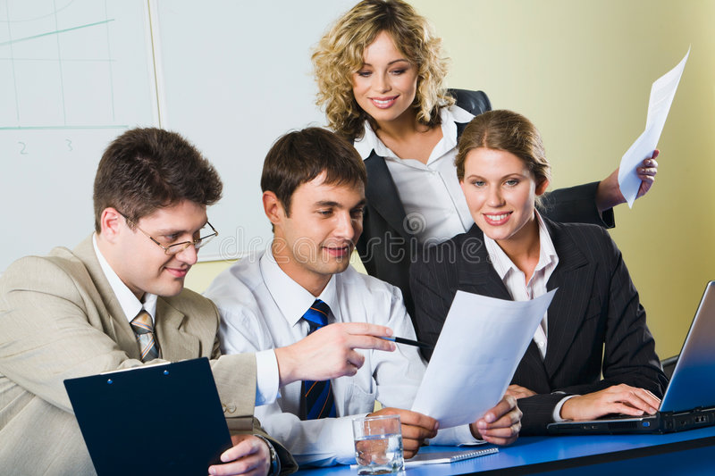 Group of people. Sitting at a blue table and discussing business questions stock photo