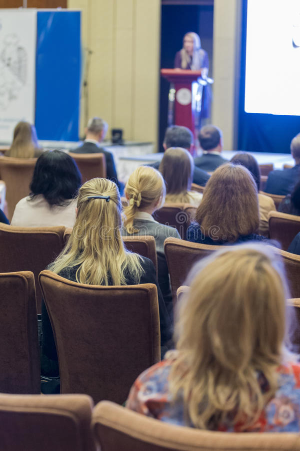 Group of People Attending Conference and Listening to the Host Speaker royalty free stock photography