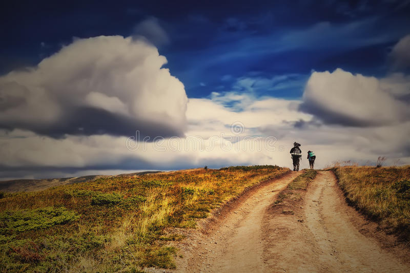 Group people with backpack under dramatic blue sky royalty free stock photos