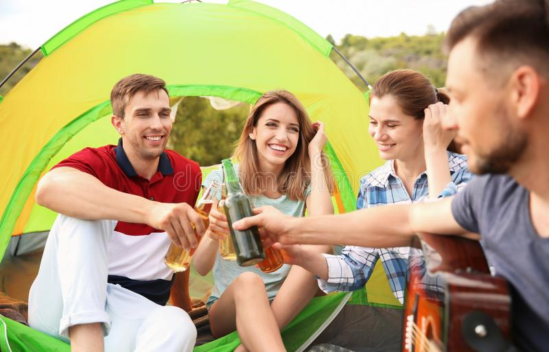 Group of people with beer in wilderness. Camping season. Group of young people with beer in wilderness. Camping season royalty free stock photo