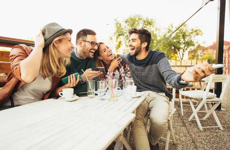 Group of people at cafe talking laughing stock image