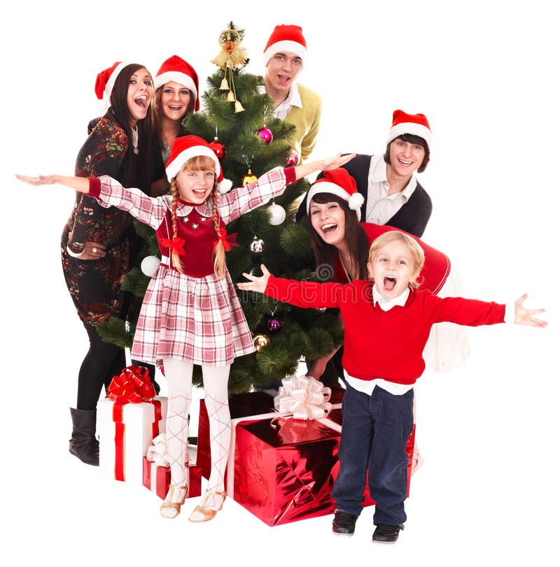 Christmas Family Party Games: Group People Children In Santa Hat, Christmas Tree Stock