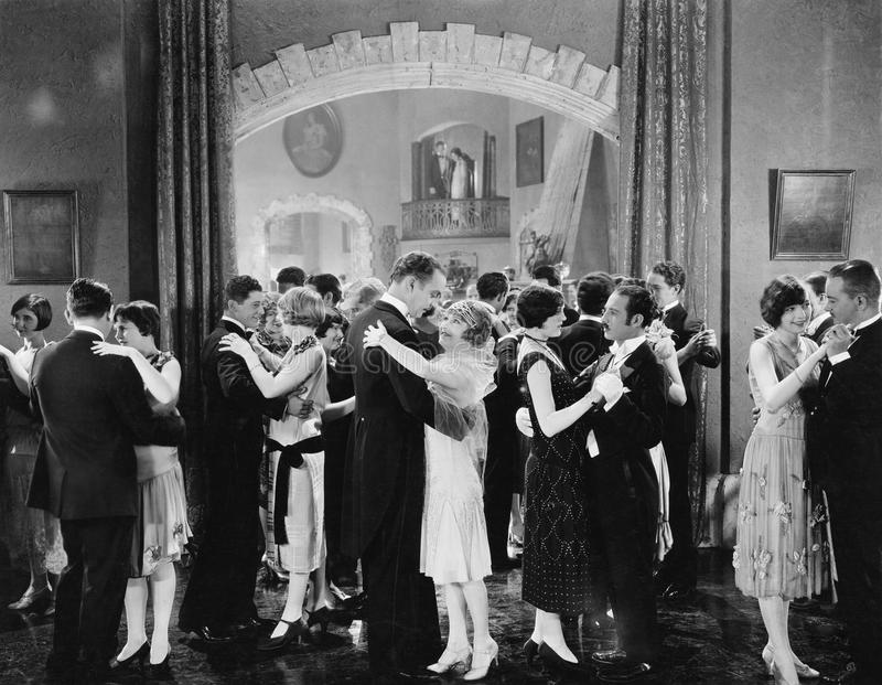 Group of people dancing in a ballroom royalty free stock photos