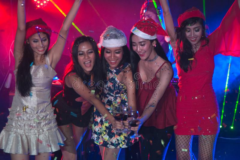 Group of people dancing at night club party. royalty free stock photo