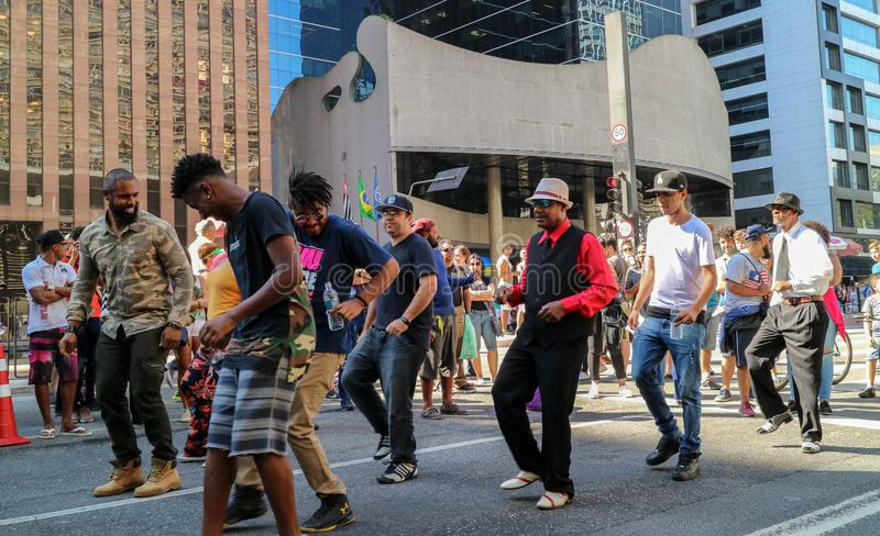 Group of people dancing together at street stock photography