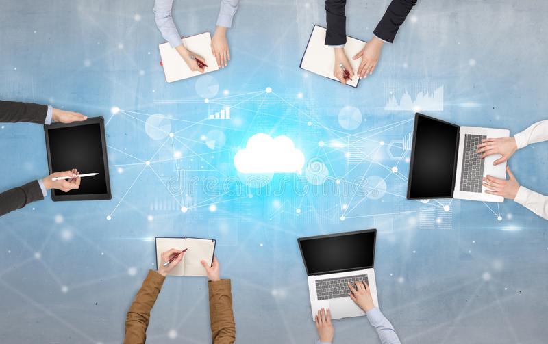 Group of people with devices in hands working on laptops and tablets with online teamwork concept. Group of people with devices in hands working on reports with royalty free stock image
