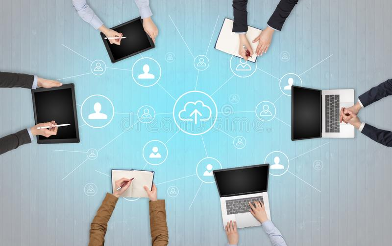 Group of people with devices in hands working on laptops and tablets with office concept. Group of people with devices in hands working in team on tablets stock images