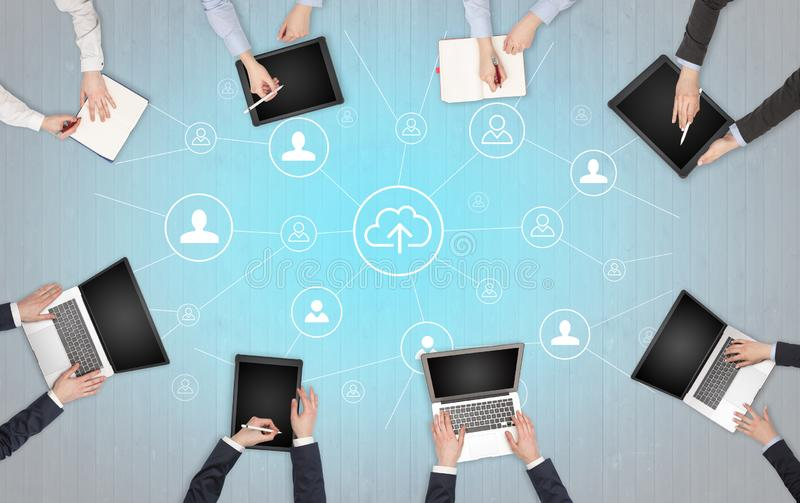 Group of people with devices in hands working on laptops and tablets with office concept. Group of people with devices in hands working in team on tablets royalty free stock photography