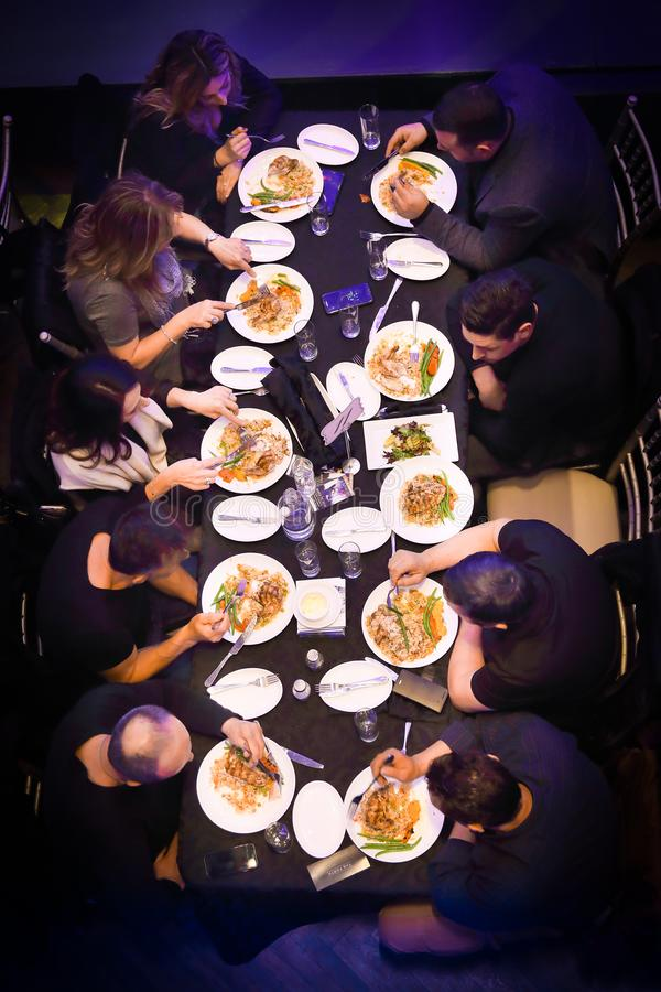 Group of people dining or eating royalty free stock image