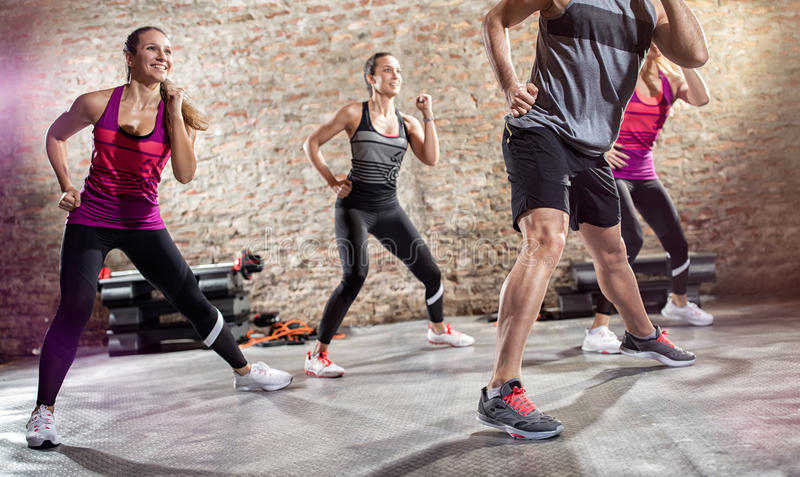 Group of people doing exercise with music stock photography