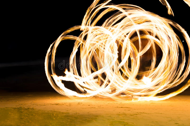 Group of people doing Fire show on beach party stock photos