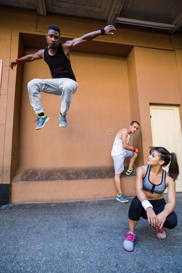 Group of people doing parkour in the city stock images