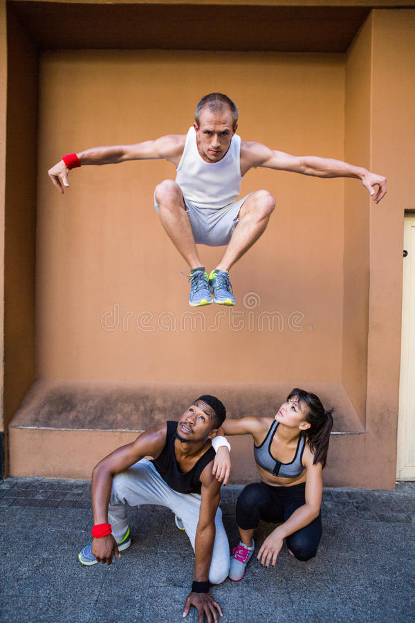 Group of people doing parkour in the city stock photo