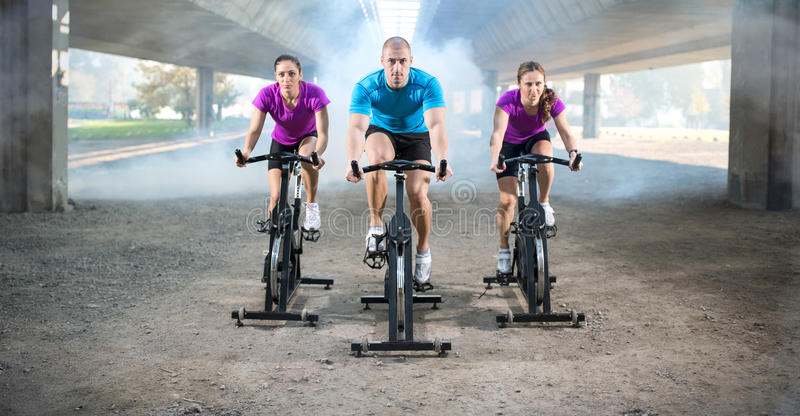 Group of people doing spinning on cycle bike royalty free stock images