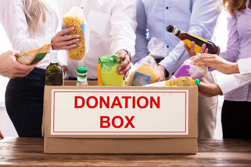 Group Of People Donating Food royalty free stock image