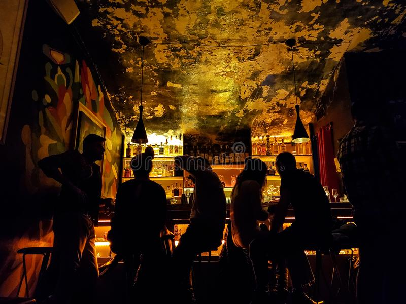 Group of people drinking at bar in night time,nightlife atmosphere concept. S royalty free stock photography