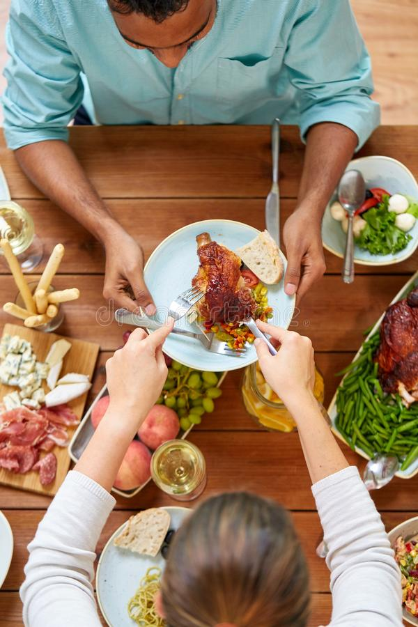 Group of people eating chicken for dinner royalty free stock photography