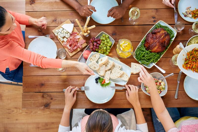 Group of people eating at table with food royalty free stock photos