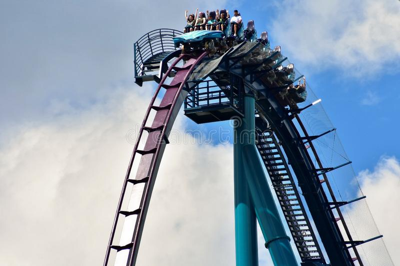 A Group of people enjoy a fast roller coaster ride located at International Drive Area. royalty free stock image