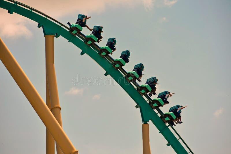 Group of people enjoy a Kraken roller coaster ride at Seaworld Ocean Marine Theme Park stock image