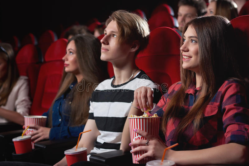 Group of people enjoying movie at the cinema royalty free stock images