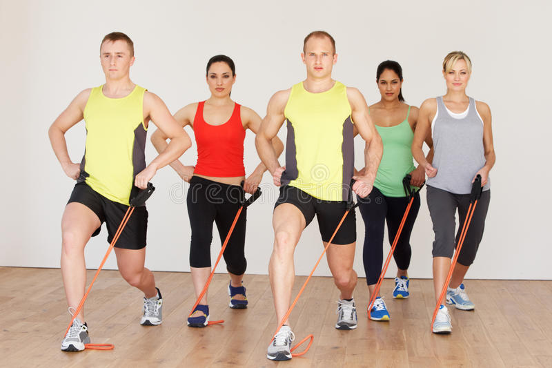 Group Of People Exercising In Gym stock photo
