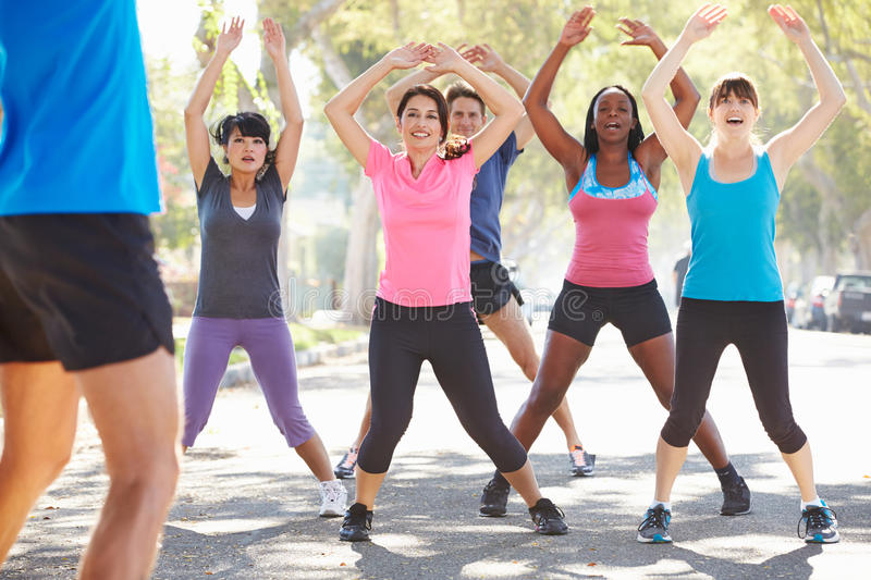 Group Of People Exercising Street With Personal Trainer royalty free stock photo