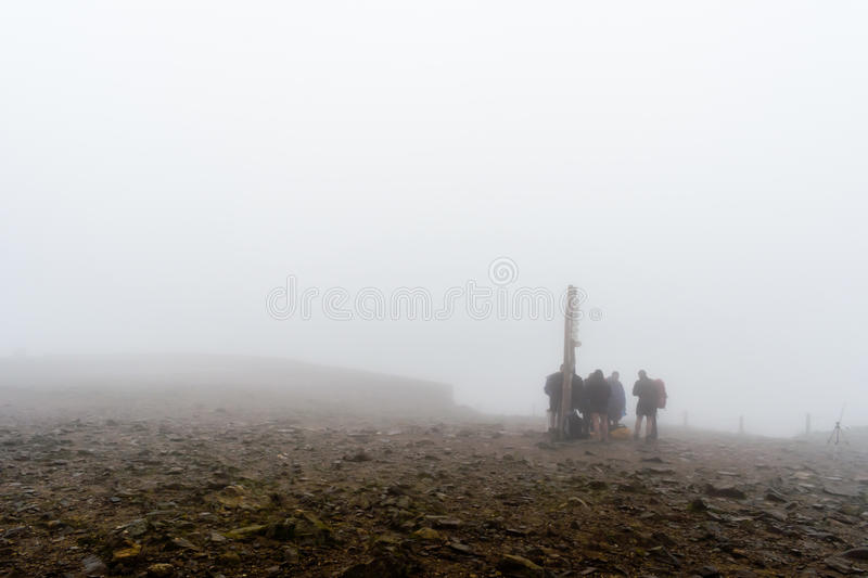 Group of people in fog stock photography