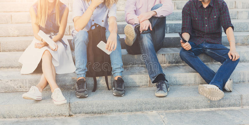Group of people with gadgets outdoor stock photo