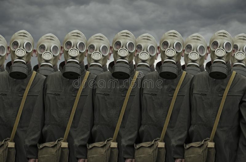 Group of people in gas mask stock photos