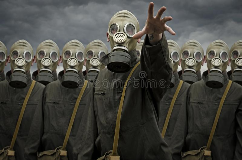 Group of people in gas mask stock photo