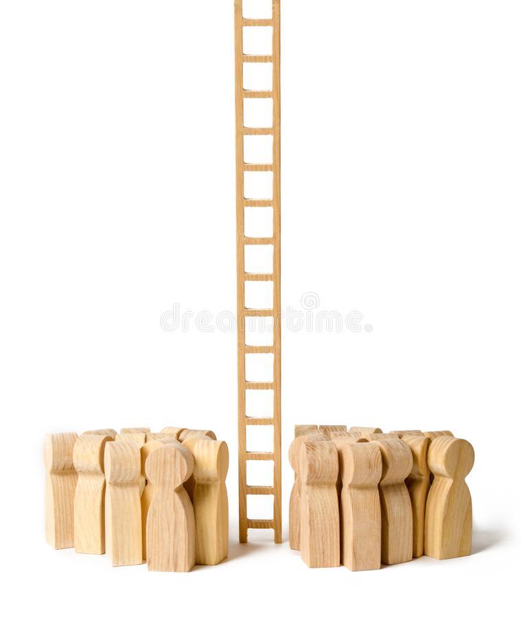A group of people gathered at a long stairs. Raising and moving up the career ladder. difficult way to success. Support and help royalty free stock images