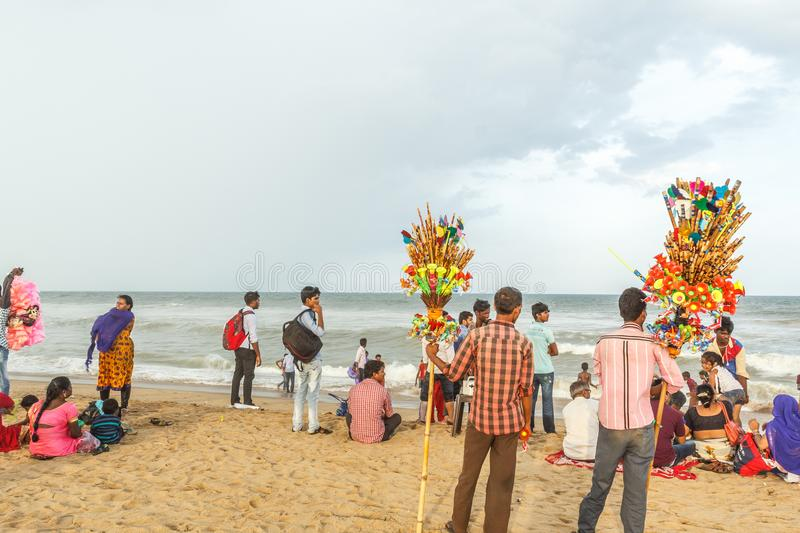 Group of people gathered at Marina beach, having fun in the ocean waves with beautiful clouds,Chennai,India 19 aug 2017. Group of people gathered at Marina beach royalty free stock image