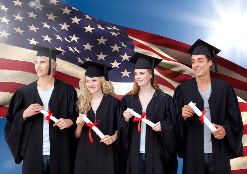 Group Of People In Graduation Gown Standing Against American Flag ...