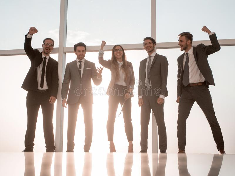 A group of people with great success holds. royalty free stock photography