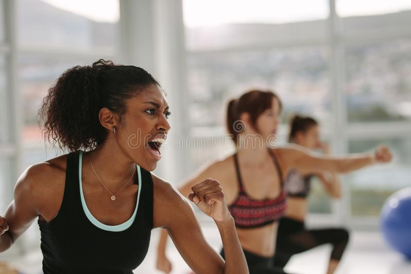 Group of people in gym class having punch training stock photos