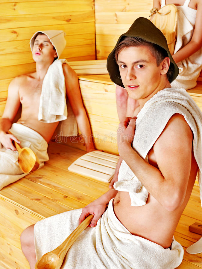 Group People In Hat  At Sauna. Royalty Free Stock Photography