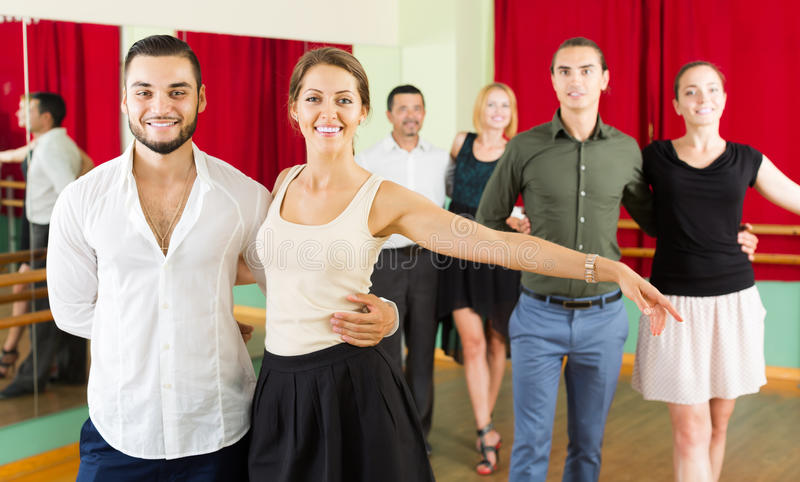 Group of people have fun while dancing waltz. Adult group of people have fun while dancing waltz stock photography