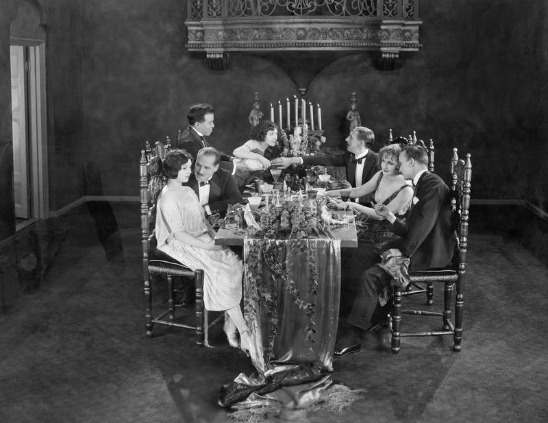 Group of people having dinner party stock photos