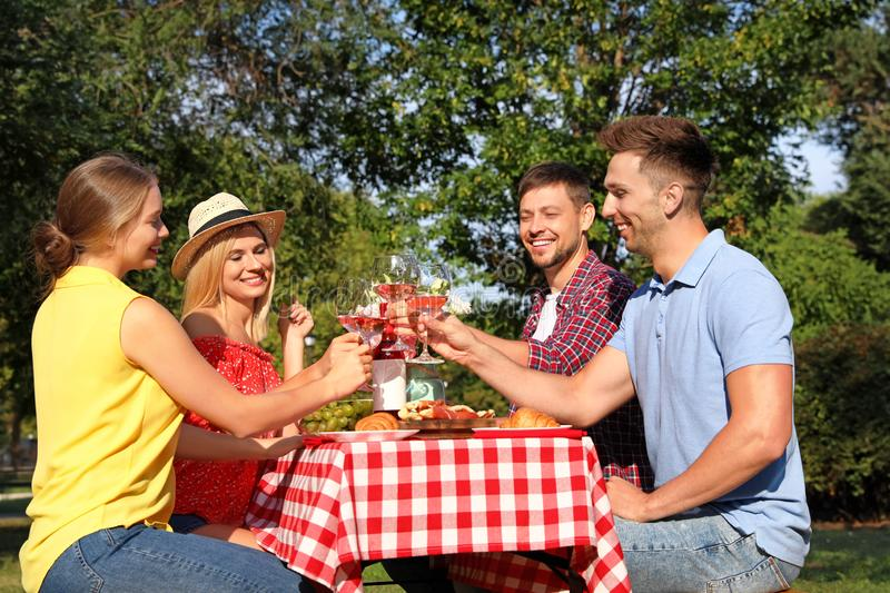Group of people having picnic at table in park royalty free stock photography