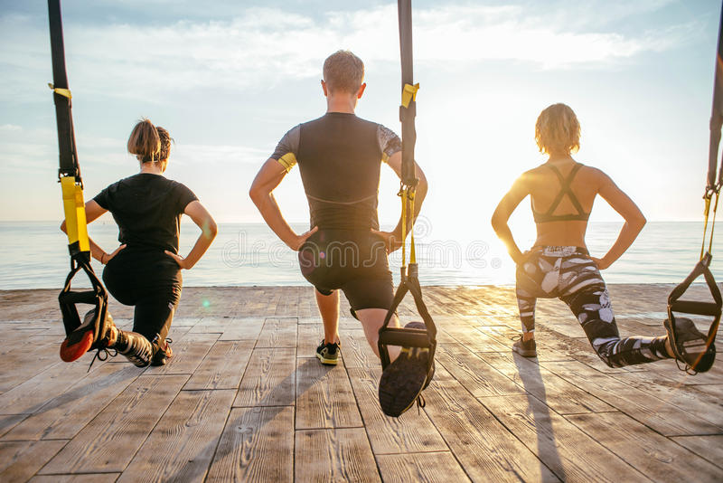 Group of people having Trx training royalty free stock photo