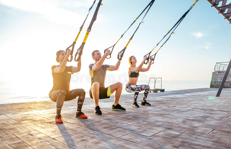 Group of people having Trx training royalty free stock images