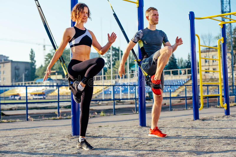 Group of people having Trx training stock images