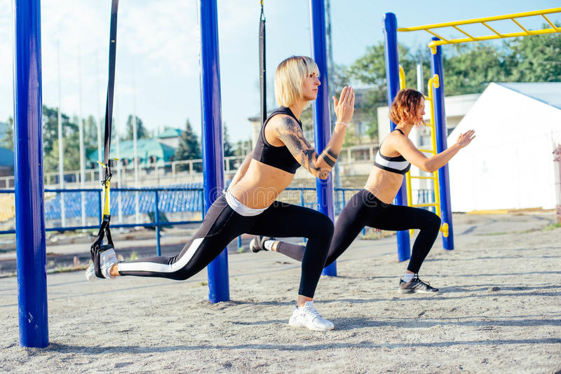Group of people having Trx training stock photography